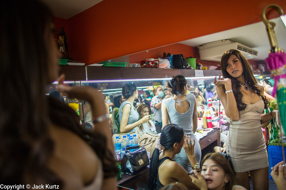 "18 JANUARY 2013 - BANGKOK, THAILAND: A transgendered sex worker gets ready for her shift in a dressing room in the Nana Entertainment District in Bangkok. Prostitution in Thailand is technically illegal, although in practice it is tolerated and partly regulated. Prostitution is practiced openly throughout the country. The number of prostitutes is difficult to determine, estimates vary widely. Since the Vietnam War, Thailand has gained international notoriety among travelers from many countries as a sex tourism destination. One estimate published in 2003 placed the trade at US$ 4.3 billion per year or about three percent of the Thai economy. It has been suggested that at least 10% of tourist dollars may be spent on the sex trade. According to a 2001 report by the World Health Organisation: ""There are between 150,000 and 200,000 sex workers (in Thailand).""          PHOTO BY JACK KURTZ"