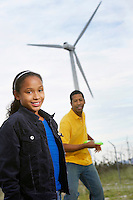 Father and daughter (7-9) playing with disc at wind farm