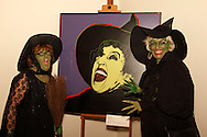 "Witches Barb Huffman of Bellbrook (left) and Lisa Appelman of West Chester stop for a picture with Andy Warhol's 'The Witch' during the Wizard of Oz party at the Dayton Art Institute, Friday, April 12, 2013.  'The Witch,'  is from 1981, and Warhol's ""Myths' portfolio according to the program and is part of the DAI collection, but is not regularly on view."