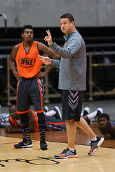 UPike Men's head basketball coach Kelly Wells, right, talks with guard Kevin Kornegay during team workouts, Wednesday, Sept. 24, 2014 at the Eastern Kentucky Expo Center in Pikeville. <br /> <br /> Photo by Jonathan Palmer, Special to the CJ