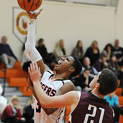 TOM KELLY IV &mdash; DAILY TIMES<br /> Marple Newtown's Marcus Weathers (3) goes up for a layup past Garnet Valley's Jack Diggory (21) during the Garnet Valley at Marple Newtown boys basketball game on Tuesday night December 9, 2014.