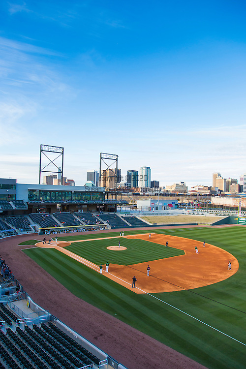 Regions Field, a baseball park in the heart of Downtown Birmingham, Alabama, is home to the local AA Baseball Team, the Barons.  Some of the stadium lights are from the historic Rickwood Field and there is a nice view of downtown Birmingham from the stadium.  Pictured here is the UAB team playing the Arkansas State.