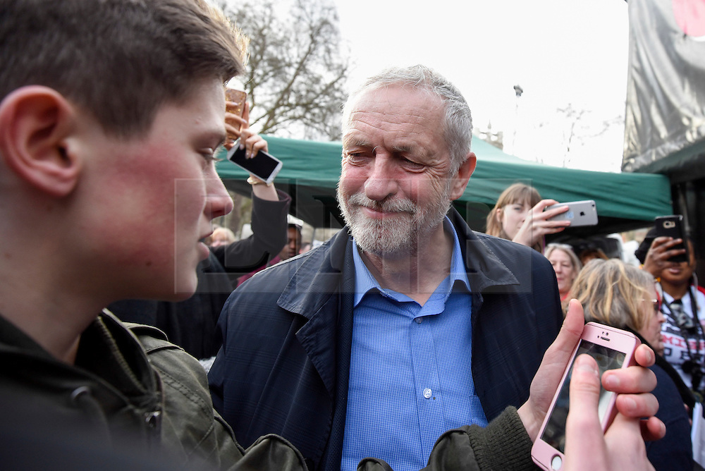 """© Licensed to London News Pictures. 04/03/2017. London, UK. Jeremy Corbyn, Labour leader, meets a young fan ahead of addressing thousands taking part in a """"Save the NHS"""" rally.  The demonstrators marched from Tavistock Square to Parliament Square protesting against funding cuts. Photo credit : Stephen Chung/LNP"""
