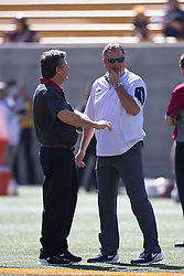 BERKELEY, CA - OCTOBER 03:  Head coach Mike Leach of the Washington State Cougars talks to head coach Sonny Dykes of the California Golden Bears before the game at California Memorial Stadium on October 3, 2015 in Berkeley, California. The California Golden Bears defeated the Washington State Cougars 34-28. (Photo by Jason O. Watson/Getty Images) *** Local Caption *** Mike Leach; Sonny Dykes