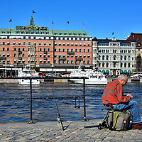 Fisherman at Strömparterren Park in Stockholm, Sweden<br /> The Helgeandsholmen islet is in the center of historic Stockholm.  In every direction are tourists, guides and buses that are racing among the landmarks. Yet at Strömparterren Park the local fishermen are oblivious to the bustle.  Instead, they patiently attend to their art of catching salmon, perch, pike, trout and other species from the rushing waters of the Norrström.