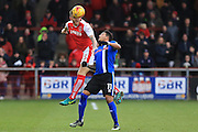 Ashley Eastham heads clear from Nathaniel Mendez-Laing during the EFL Sky Bet League 1 match between Fleetwood Town and Rochdale at the Highbury Stadium, Fleetwood, England on 11 February 2017. Photo by Daniel Youngs.