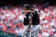 PHILADELPHIA, PA - JUNE 3: Jose Reyes #7 and Hanley Ramirez #2 of the Miami Marlins talk during the game against the Philadelphia Phillies at Citizens Bank Park on June 3, 2012 in Philadelphia, Pennsylvania. The Marlins won 5-1. (Photo by Joe Robbins)