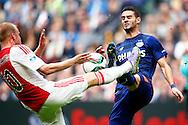 04-10-2015 VOETBAL: AJAX-PSV:AMSTERDAM<br /> Gaston Pereiro van PSV in duel met Davy Klaassen van Ajax <br /> <br /> Foto: Geert van Erven