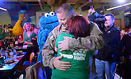 LANGHORNE, PA -  MARCH 15:  Tec Sgt. Justin Bright hugs his wife Tiffany Bright after returning from Iraq at Sesame Place March 15, 2014 in Langhorne, Pennsylvania.  (Photo by William Thomas Cain/Cain Images)