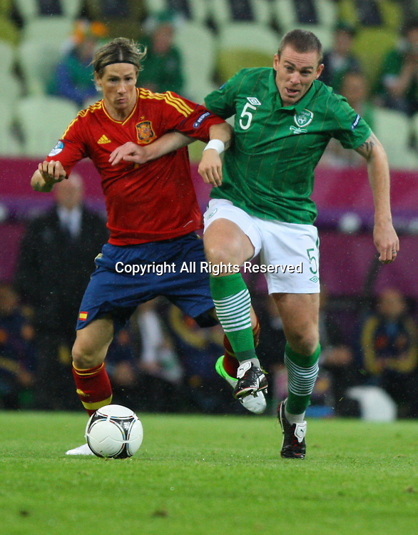 14.06.2012, GDANSK, Poland. EURO 2012, FOOTBALL EUROPEAN CHAMPIONSHIP, SPAIN versus IRELAND FERNANDO TORRES (ESP)steals the ball in the box from RICHARD DUNNE (IRL) and scored the first goal