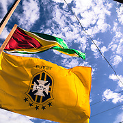 A Brazilian woman put the Brazilian football team flag outside her small shop in Lethem, Guyana