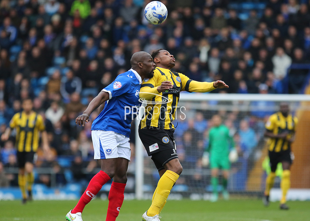 Portsmouth defender Nyron Nosworthy battles with Shrewsbury Town defender Cameron Gayle during the Sky Bet League 2 match between Portsmouth and Shrewsbury Town at Fratton Park, Portsmouth, England on 28 March 2015. Photo by Phil Duncan.