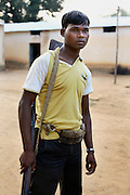 20 yr old Laxman Bhogami, an SPO militia member, seen inside the protected compound of the Bairamgarh police camp..'The Naxalites are getting stronger, it feels like their winning'.