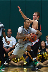 Dec 10, 2011; San Francisco CA, USA;  San Francisco Dons guard Rashad Green (13) is defended by Pacific Tigers guard Colin Beatty (2) during the second half at War Memorial Gym.  San Francisco defeated Pacific 79-69. Mandatory Credit: Jason O. Watson-US PRESSWIRE