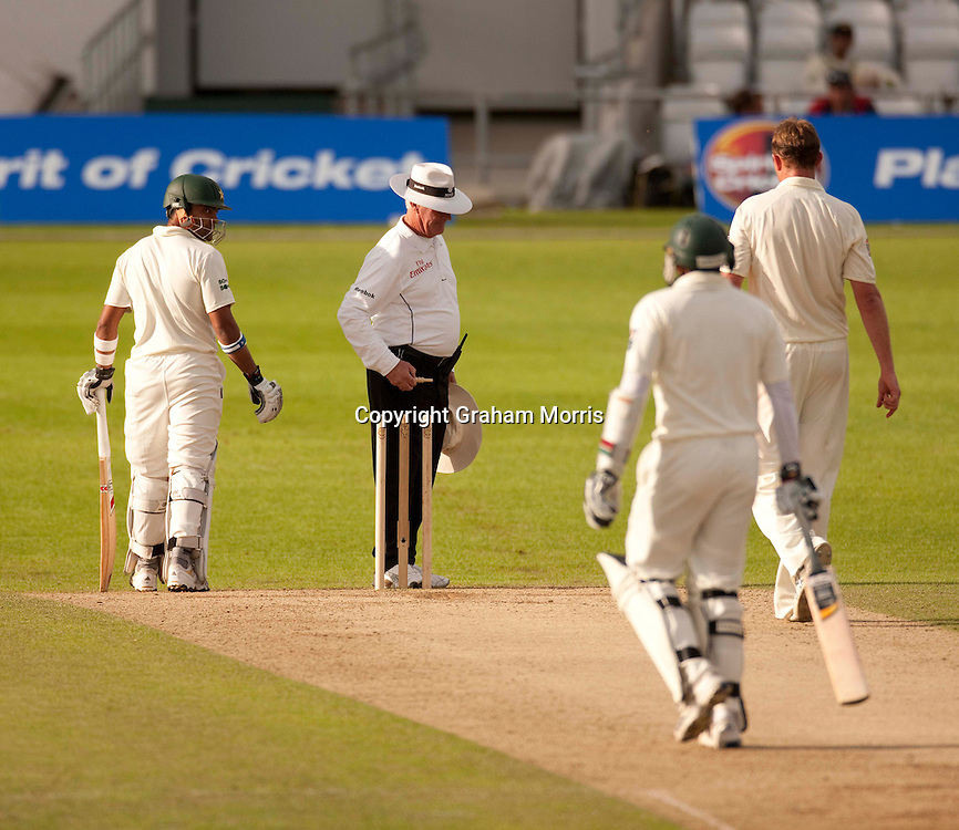 Umpire Rudi Koertzen delays his retirement by another day by removing the bails with another 40 runs to score for Pakistan to win the second MCC Spirit of Cricket Test Match against Australia at Headingley, Leeds.  Photo: Graham Morris (Tel: +44(0)20 8969 4192 Email: sales@cricketpix.com) 23/07/10