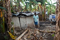 Klezian Francois, 46,  stands outside her home, which was flooded, filled with mud and practically destroyed during Hurricane Sandy. Hurricane Sandy brought heavy flooding to the region , destroyed crops and livestock and will seriously hinder farmers' abilities to grow food in the future.