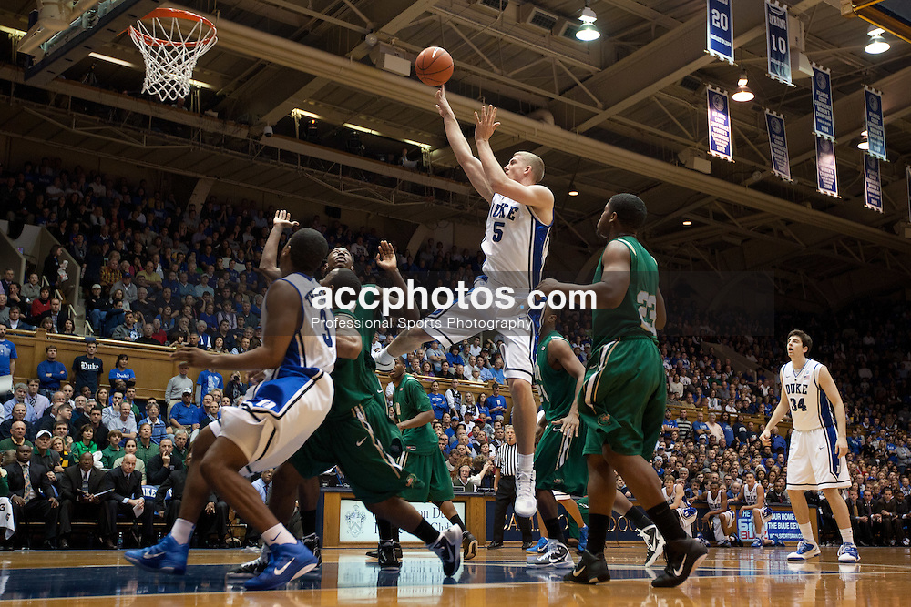 DURHAM, NC - JANUARY 05: Mason Plumlee #5 of the Duke Blue Devils shoots a basket while defended by Cameron Moore #22 of the Alabama Birmingham Blazers on January 05, 2011 at Cameron Indoor Stadium in Durham, North Carolina. Duke won 64-85. (Photo by Peyton Williams/Getty Images) *** Local Caption *** Mason Plumlee;Cameron Moore