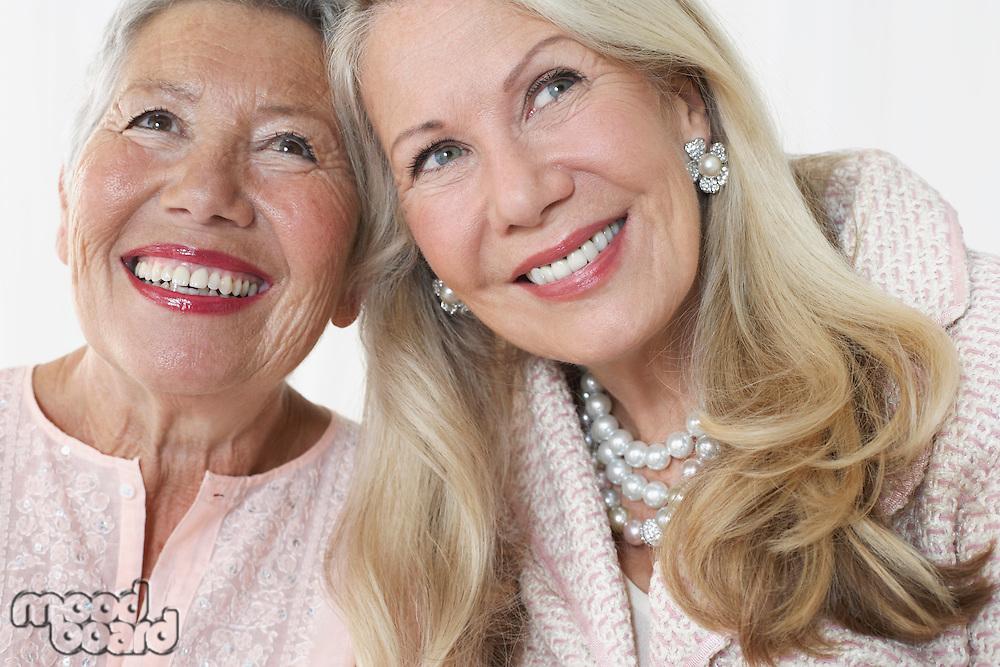 Two elegant senior woman in studio head and shoulders