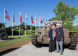 "© Licensed to London News Pictures. 29/05/2014. Sid and Jean Williams stand in front of one of the only two remaining British Centurion tanks that were used in the landings.  Sid, now 93 drove one of the tanks during the landings on Juno beach and this is the first time he has seen one since the war.  ""We have to waterproof everything.  We got dropped in the sea and drove up the beaches.  All we could see were people dyeing all around us.""  Commented Sid as he reminisced on the landings.   . Photo credit : Alison Baskerville/LNP"