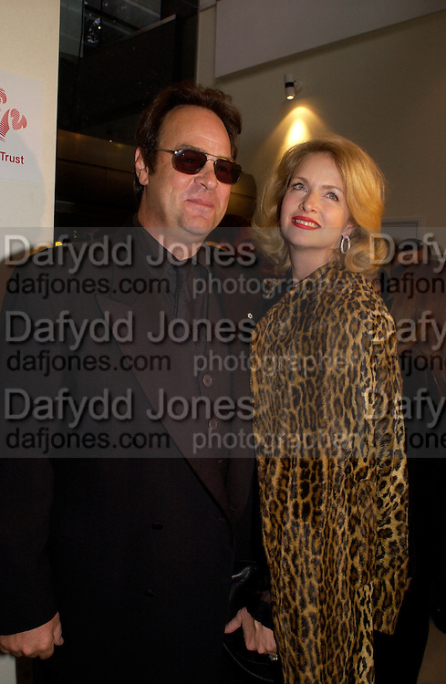 Dan Akroyd and Donna Dixon, Bright Young Things Royal European charity premiere in Leicester Sq. and party afterwards at  Claridges, 28 September 2003. © Copyright Photograph by Dafydd Jones 66 Stockwell Park Rd. London SW9 0DA Tel 020 7733 0108 www.dafjones.com