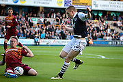 Milwall midfielder Shane Ferguson has his shot blocked during the Sky Bet League 1 play-off second leg match between Millwall and Bradford City at The Den, London, England on 20 May 2016. Photo by Nigel Cole.