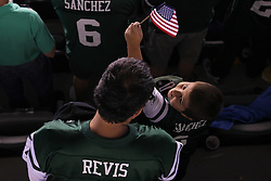 Sept 11, 2011; East Rutherford, NJ, USA;  A father and his son during pre-game ceremonies commemorating the 10th Anniversary of 9/11 before the game between the New York Jets and the Dallas Cowboys at MetLife Stadium.