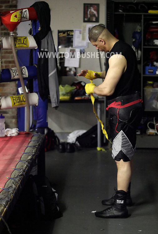 Dewey Bozella of Newburgh gets ready to spar at the Newburgh Boxing Club on Wednesday, April 13, 2011.