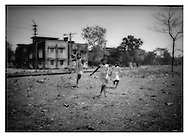 Girls playing along the rails in their Sunday dresses, Siliguri, West Bengal.