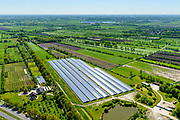 Nederland, Friesland, gemeente Tietjerksteradeel, 07-05-2018; Garyp, een van de eerste en grootste zonneparken van Nederland, gerealiseerd op een voormalige vuilstortplaats. Het zonnepark is een initiatief van bewoners verenigd in 'Enerzjy Ko&ouml;peraasje Garyp&rsquo;<br /> Garyp, small village in North-Friesland. One of the first and largest solar parks in the Netherlands, realized on a former landfill. The solar park is an initiative of the residents.<br /> luchtfoto (toeslag op standard tarieven);<br /> aerial photo (additional fee required);<br /> copyright foto/photo Siebe Swart
