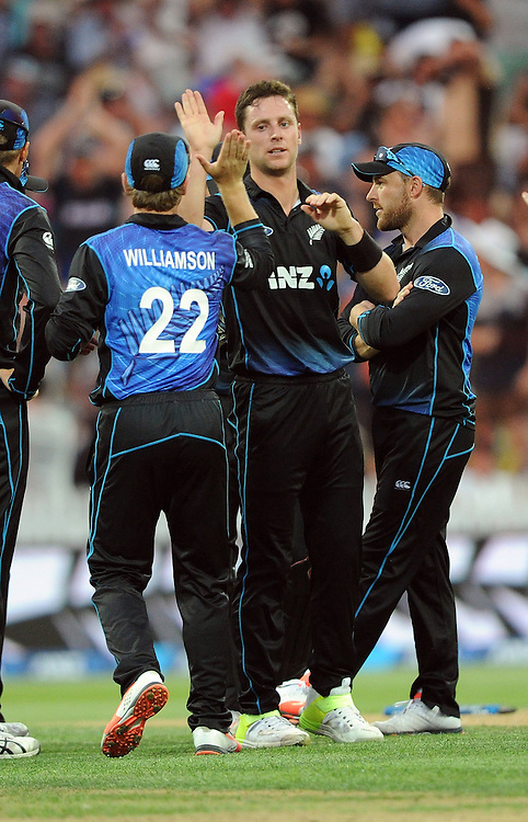 New Zealand's Matt Henry, centre, after bowling Australia's George Bailey for 33 in the 3nd One Day International Cricket match at Seddon Park, Hamilton, New Zealand, Monday, February 08, 2016. Credit:SNPA / Ross Setford