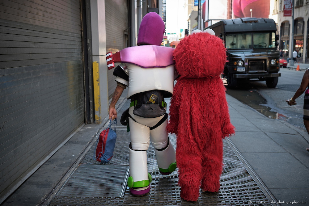 Joshua  and Virgilia alias Buz Lightyear and Elmo go back to Times Square after they had a short lunchbreak.