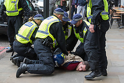 London, November 6th 2016. Police pin a man to the ground following a scuffle on Islington High Street after the North London Derby between Arsenal FC and Tottenham Hotspur, that ended in a 1-1 draw.