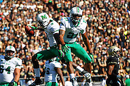 WEST LAFAYETTE, IN - SEPTEMBER 29: Ryan Riedel #99 of the Marshall Thundering Herd and C.J. Crawford #21 of the Marshall Thundering Herd celebrate a touchdown at Ross-Ade Stadium on September 29, 2012 in West Lafayette, Indiana. (Photo by Michael Hickey/Getty Images) *** Local Caption *** Ryan Riedel; C.J. Crawford