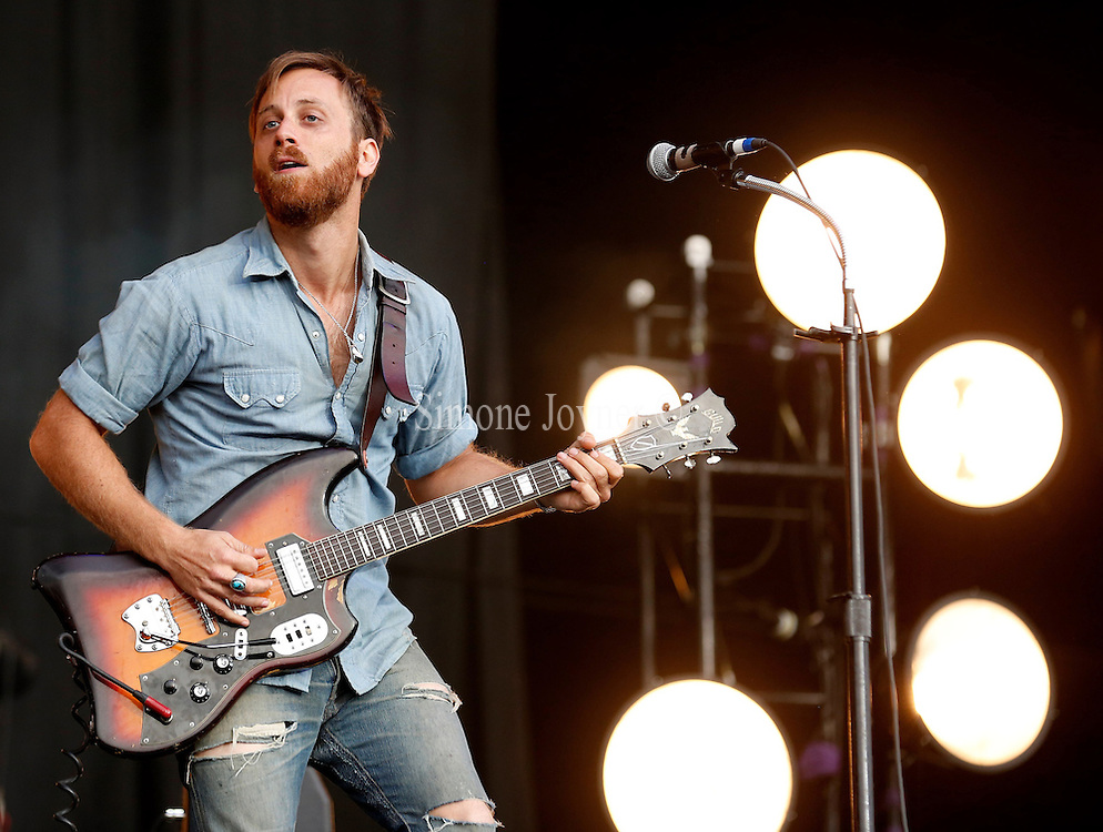 READING, ENGLAND - AUGUST 26:  Dan Auerbach of The Black Keys  performs live on the Main Stage on Day Three during the Reading Festival 2012 at Richfield Avenue on August 26, 2012 in Reading, England.  (Photo by Simone Joyner/WireImage)