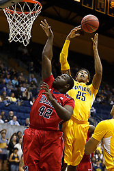 March 16, 2011; Berkeley, CA, USA;  California Golden Bears forward Richard Solomon (25) grabs a rebound from Mississippi Rebels center Demarco Cox (42) during the first half of the first round of the National Invitation Tournament at Haas Pavilion.