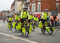 St John's Ambulance first aiders accompany the cyclists as they ride along Putney High Street during The Prudential RideLondon Sportives. Sunday 29th July 2018<br /> <br /> Photo: Ben Queenborough for Prudential RideLondon<br /> <br /> Prudential RideLondon is the world's greatest festival of cycling, involving 100,000+ cyclists - from Olympic champions to a free family fun ride - riding in events over closed roads in London and Surrey over the weekend of 28th and 29th July 2018<br /> <br /> See www.PrudentialRideLondon.co.uk for more.<br /> <br /> For further information: media@londonmarathonevents.co.uk