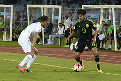 October 8, 2017 - Kolkata, West Bengal, India - Mexico mid fielder Diego Lainez (right) and Iraqi defender Habeeb Mohammed (left) in action during the FIFA U 17 World Cup India 2017 Group F matches in Kolkata. Player of Mexico and Iraq in action during the FIFA U 17 World Cup India 2017 Group F match on October 9, 2017 in Kolkata (Credit Image: © Saikat Paul/Pacific Press via ZUMA Wire)