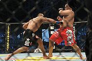 "ABU DHABI, UNITED ARAB EMIRATES, APRIL 10, 2010: Mostafa Al Turk (black shorts) and Jon Madsen (red shorts) during  ""UFC 112: Invincible"" inside Ferari World, Abu Dhabi on April 10, 2010."