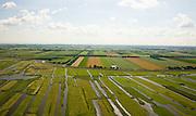 Nederland, Noord-Holland, Schermer, 14-07-2008; Eilandspolder in de voorgrond, voormalig veeneiland tussen de toenmalige meren Schermer en Beemster; de polder Beemster, op het tweede plan,  kent een strakke verkaveling (geometrische raster), dit in tegenstelling tot het grillige landschap van de Eilandspolder, die onstaan door drainage en vervening (winnen van turf); de Eilandspolder is in gebruik als weide- en hooiland en is beschermd natuurgebied voor water- en weidevogels, nat grasland en moeras; watervogel*, veen. .luchtfoto (toeslag); aerial photo (additional fee required); .foto Siebe Swart / photo Siebe Swart