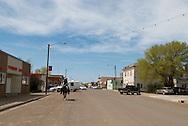 Cowboy rides through town in Circle Montana