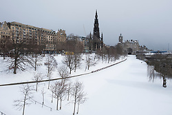 Princes Street Gardens in Edinburgh covered in thick snow after heavy snow storms, Scotland, United kingdom
