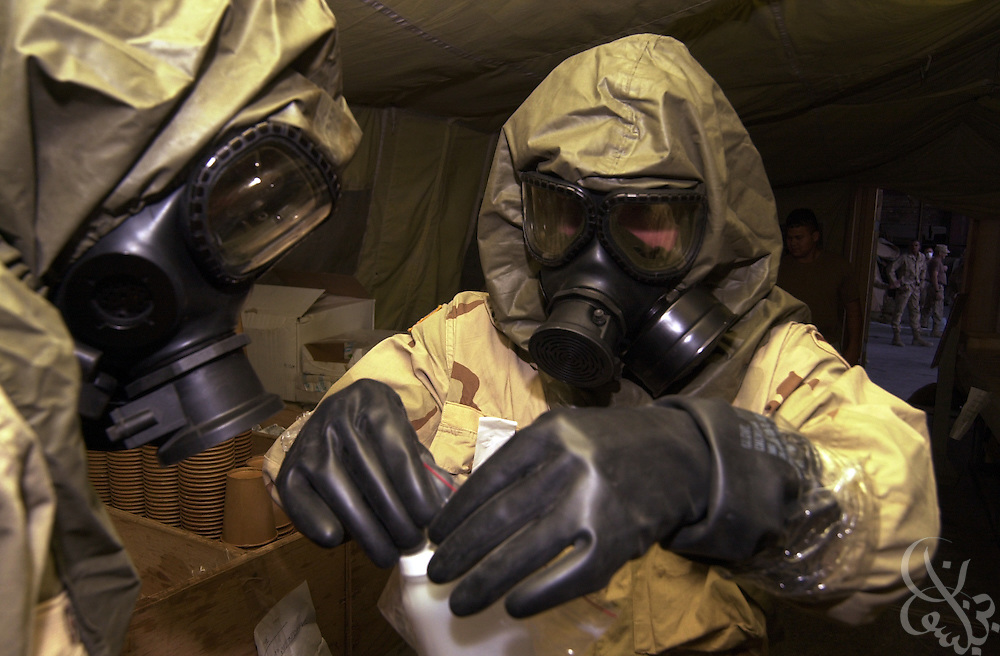 U.S. Army soldiers from the 310th Chemical Company perform a mock chemical agent drill July 22, 2002 at Bagram airbase in Afghanistan. Al Qaeda and Taliban forces are suspected of having biological and chemical agents in their arsenals. To date no such biological or chemical weapons have been found in raids on suspected storage sites within Afghanistan.