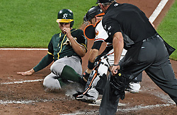 August 22, 2017 - Baltimore, MD, USA - The Oakland Athletics' Chad Pinder, left, is tagged out by Baltimore Orioles catcher Caleb Joseph on a fielder's choice in the eighth inning at Oriole Park at Camden Yards in Baltimore on Tuesday, Aug. 22, 2017. The A's won, 6-4. (Credit Image: © Kenneth K. Lam/TNS via ZUMA Wire)