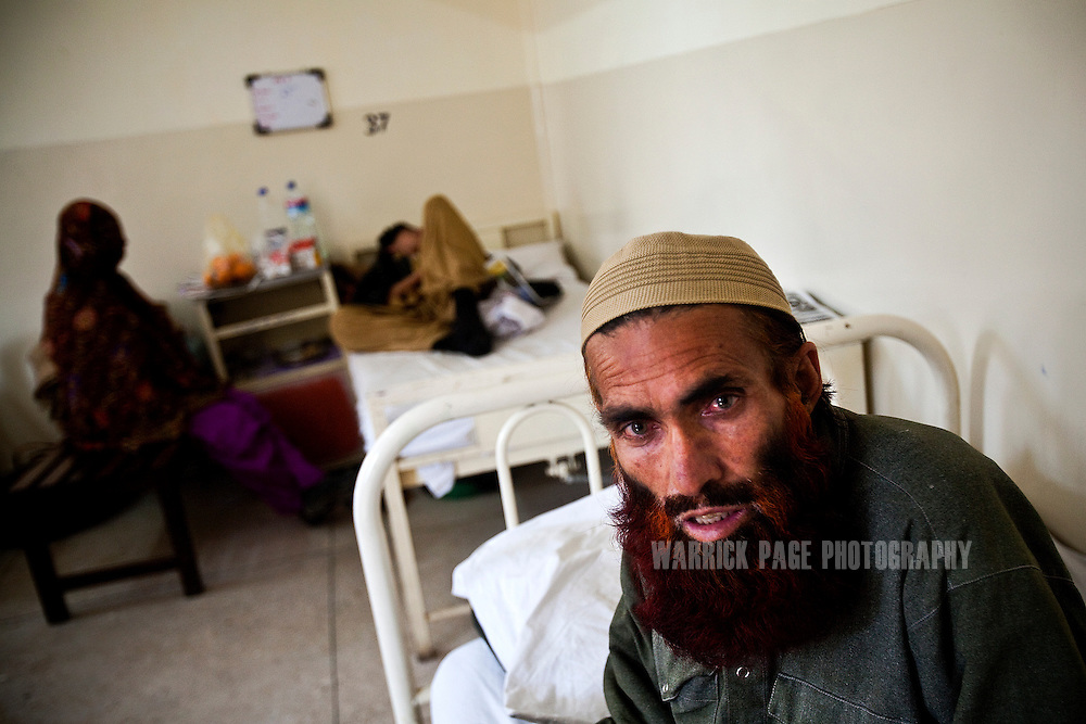 ISLAMABAD, PAKISTAN - FEBRUARY 17: Resham Khan sits on his hospital bed in PIMS Hospital, on February 17, 2011, in Islamabad, Pakistan. Fifteen members of Khan's extended family and dozens of others were killed in what he said was a U.S. drone aircraft strike on a funeral procession last year. Khan suffers from severe mental trauma after seeing the incident take place. Since 2004, the CIA has waged warfare from the skies over tribal regions of Pakistan, with hundreds of strikes killing an estimated 1800-3500 with nearly 50% of those killed being civilian, according to the Bureau of Investigative Journalism. The CIA contests this saying 600 militants have been killed since May 2010, with no civilian casualties.  (Photo by Warrick Page)