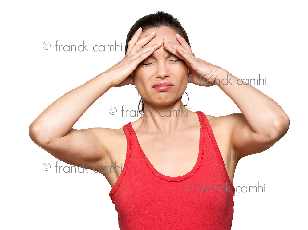 Portrait of expressive woman with severe headache in studio isolated on white background