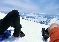 Legs of resting climbers on Mt. Rainier, Washington State USA<br />