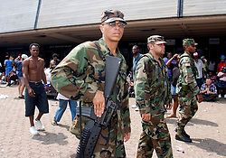 31st August, 2005. New Orleans Louisiana.  Hurricane Katrina.  'Hell on earth.' The Superdome in New Orleans, Louisiana where over 20,000 refugees from hurricane Katrina are crammed into hellish conditions. Armed guardsmen patrol the perimeter of the superdome.<br /> Photo Credit: Charlie Varley/varleypix.com