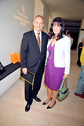 GRAHAM BOYES and GAIL REBUCK winner of the Veuve Clicquot Business Woman Award 2009 at the presentation of the Veuve Clicquot Business Woman Award 2009 hosted by Graham Boyes MD Moet Hennessy UK and presented by Sir Trevor Macdonald at The Saatchi Gallery, Duke of York's Square, Kings Road, London SW1 on 28th April 2009.
