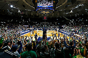 Notre Dame Fighting Irish students throw paper in the air after the first basket during action at Purcell Pavillion in South Bend, Indiana.