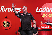 Mervyn King knocks Michael van Gerwen out of the UK Open in the fourth round and celebrates during the Ladrokes UK Open 2019 at Butlins Minehead, Minehead, United Kingdom on 1 March 2019.